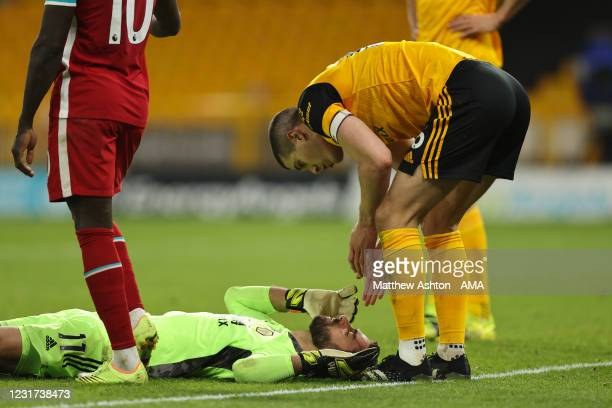 Conor Coady of Wolverhampton Wanderers checks on Rui Patricio after they collided during the Premier League match between Wolverhampton Wanderers and...