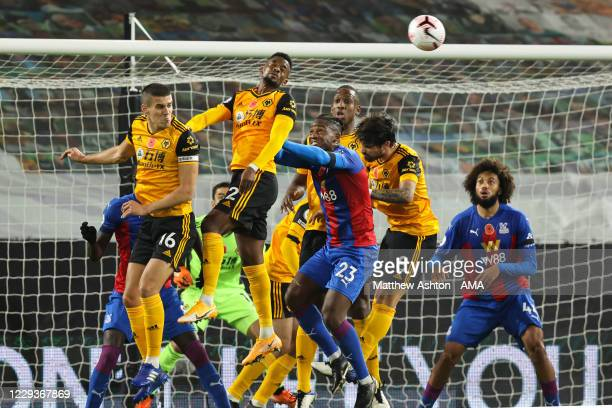 Conor Coady of Wolverhampton Wanderers clears from a corner during the Premier League match between Wolverhampton Wanderers and Crystal Palace at...