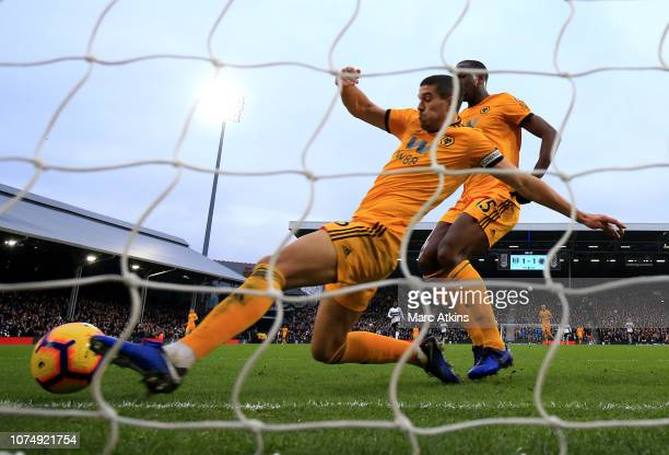 Conor Coady of Wolverhampton Wanderers clears the ball off the line during the Premier League match between Fulham FC and Wolverhampton Wanderers at...