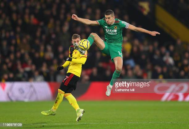 Conor Coady of Wolverhampton Wanderers controls the ball ahead of Gerard Deulofeu of Watford during the Premier League match between Watford FC and...