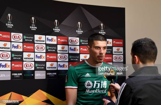 Conor Coady of Wolverhampton Wanderers gets interviewed after the UEFA Europa League round of 16 first leg match between Olympiacos FC and...