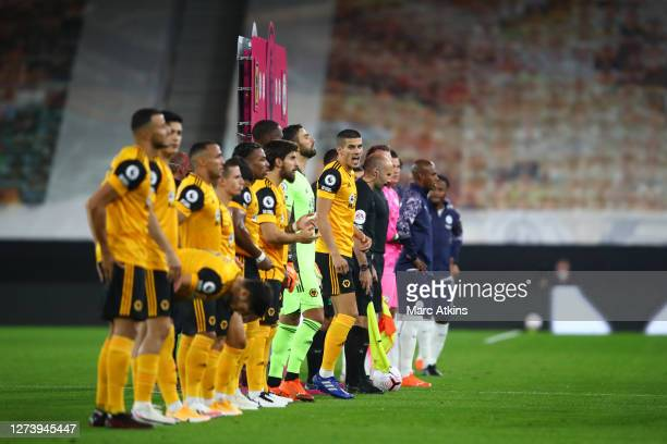 Conor Coady of Wolverhampton Wanderers looks on as the teams line up prior to the Premier League match between Wolverhampton Wanderers and Manchester...
