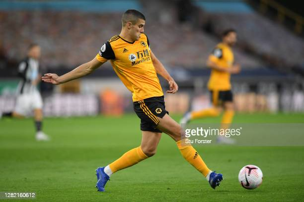 Conor Coady of Wolverhampton Wanderers passes the ball during the Premier League match between Wolverhampton Wanderers and Newcastle United at...