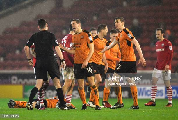 Conor Coady of Wolverhampton Wanderers reacts after a challenge by Alex Mowatt of Barnsley fouled Jack Price during the Sky Bet Championship match...