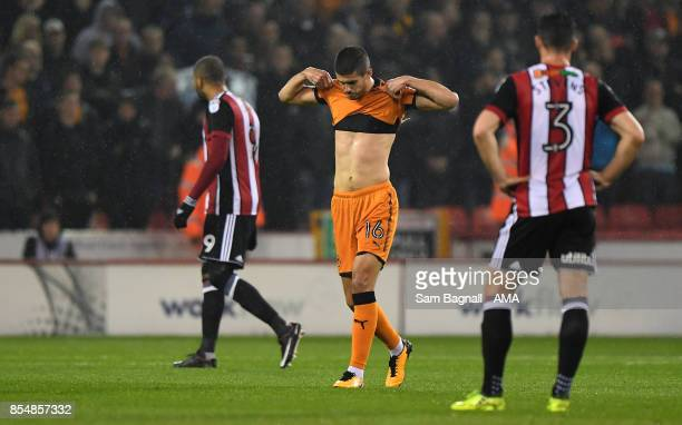 Conor Coady of Wolverhampton Wanderers reacts after being sent off for a professional foul during the Sky Bet Championship match between Sheffield...