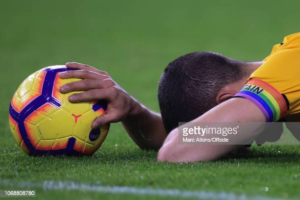 Conor Coady of Wolverhampton Wanderers reacts after scoring an own goal during the Premier League match between Wolverhampton Wanderers and Chelsea...