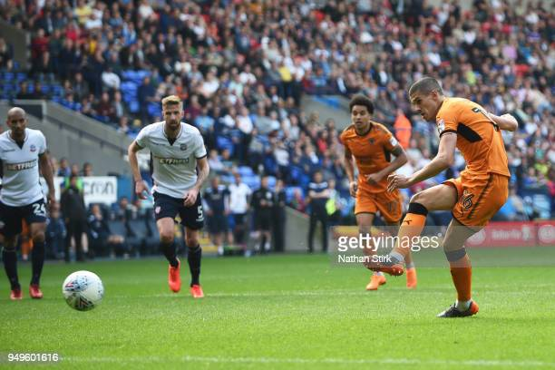 Conor Coady of Wolverhampton Wanderers scores a penalty during the Sky Bet Championship match between Bolton Wanderers and Wolverhampton Wanderers at...