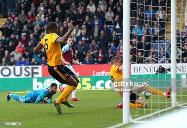 Conor Coady of Wolverhampton Wanderers scores an own goal as Chris Wood of Burnley's shot hits the post during the Premier League match between...