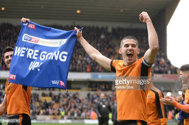 Conor Coady of Wolverhampton Wanderers shows appreciation to the fans as he celebrates victory and gaining promotion to the Premier League after the...