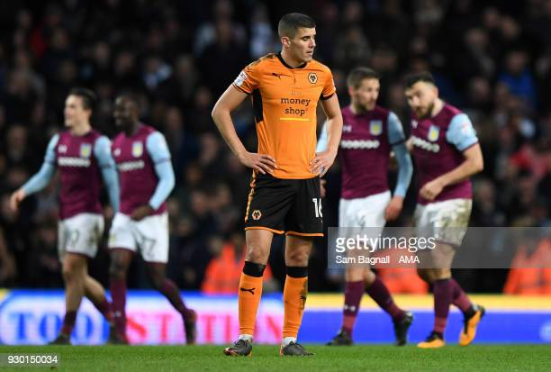 Conor Coady of Wolverhampton Wanderers stands dejected during the Sky Bet Championship match between Aston Villa and Wolverhampton Wanderers at Villa...