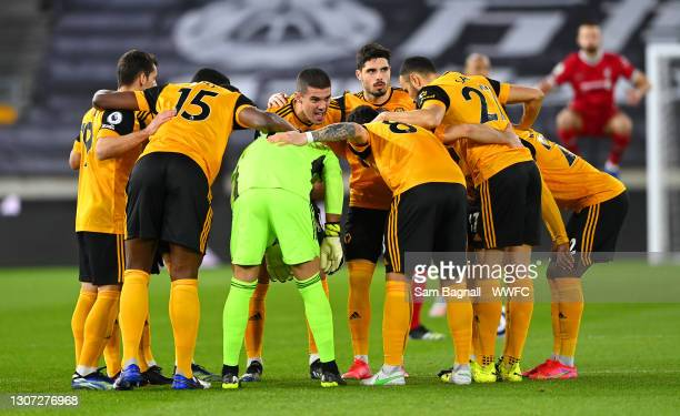 Conor Coady of Wolverhampton Wanderers talks to his team mates in a huddle prior to the Premier League match between Wolverhampton Wanderers and...