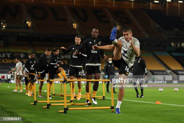 Conor Coady of Wolverhampton Wanderers warms up ahead of the Premier League match between Wolverhampton Wanderers and Crystal Palace at Molineux on...