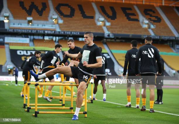 Conor Coady of Wolverhampton Wanderers warms up ahead of the Premier League match between Wolverhampton Wanderers and Newcastle United at Molineux on...
