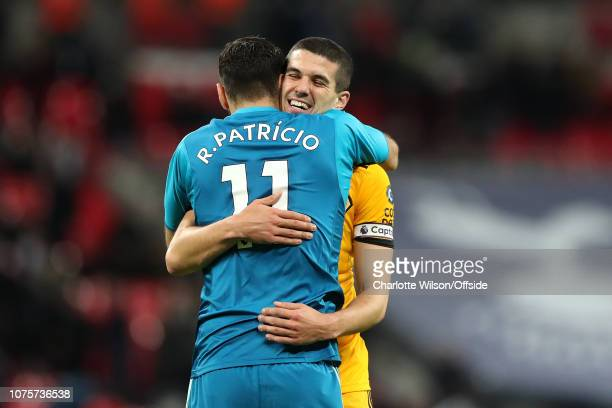 Conor Coady of Wolves celebrates their win with Wolves goalkeeper Rui Patricio during the Premier League match between Tottenham Hotspur and...