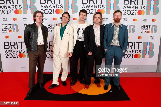 Conor Curley, Carlos O'Connell, Grian Chatten, Conor Deegan III and Tom Coll of Fontaines DC arrives at The BRIT Awards 2021 at The O2 Arena on May...