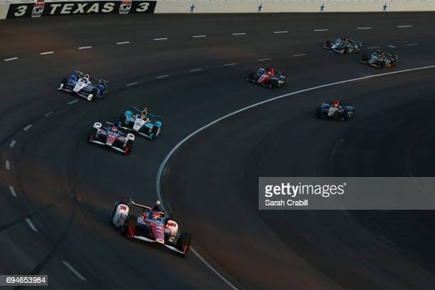 Conor Daly driver of the ABC Supply AJ Foyt Racing Chevrolet leads a pack of cars during the Verizon IndyCar Series Rainguard Water Sealers 600 at...