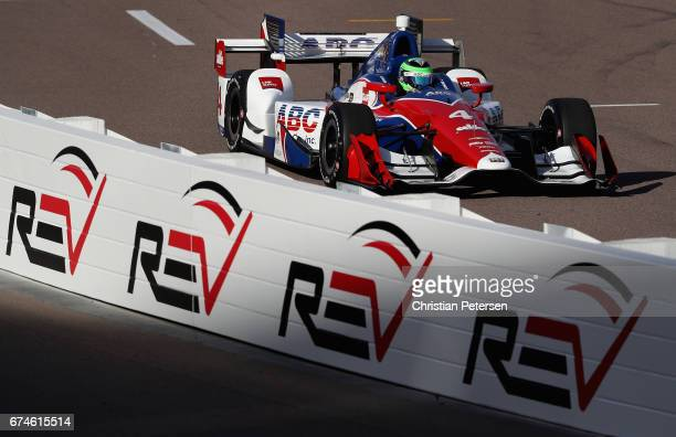Conor Daly driver of the AJ Foyt Enterprises Chevrolet drives out of the pitt area during practice for the Desert Diamond West Valley Phoenix Grand...