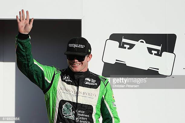 Conor Daly driver of the Dale Coyne Racing Honda IndyCar is introduced before the Phoenix Grand Prix at Phoenix International Raceway on April 2 2016...