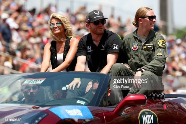 Conor Daly of USA driver of the Andretti Autosport Honda looks on during the traditional pre race parade through downtown Indianapolis on May 25 2019...