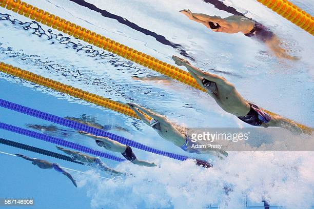 Conor Dwyer of the United States Paul Biedermann of Germany and James Guy of Great Britain compete in the first Semifinal of the Men's 200m Freestyle...