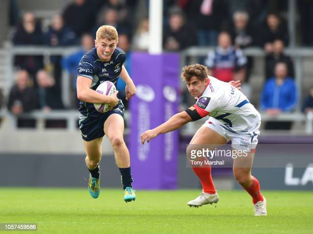 Conor Fitzgerald of Connacht Rugby gets away from Rohan Janse Van Rensburg of Sale Sharks during the Challenge Cup match between Sale Sharks and...