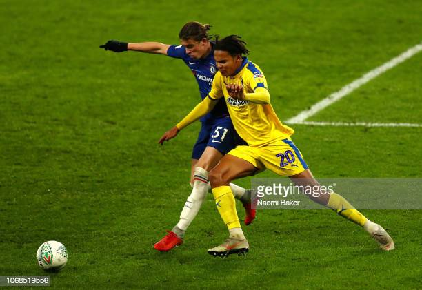 Conor Gallagher of Chelsea battles for posession with Toby Sibbick of AFC Wimbledon during the Checkatrade Trophy second round match between Chelsea...