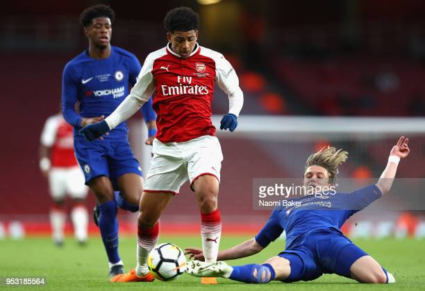 Conor Gallagher of Chelsea FC tackles Bukayo Saka of Arsenal FC during the FA Youth Cup Final second leg match between Arsenal and Chelsea at...