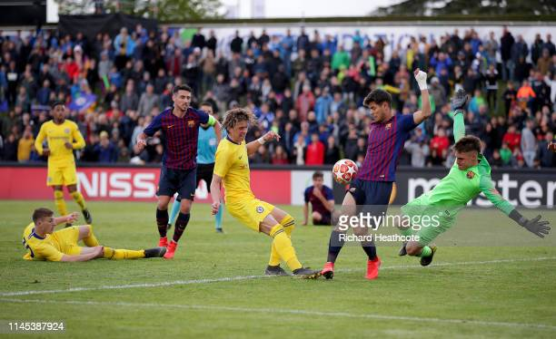 Conor Gallagher of Chelsea has a shot blocked during the FC Barcelona v Chelsea UEFA Youth League Semi Final at Colovray Sports Centre on April 26...
