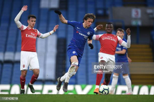Conor Gallagher of Chelsea moves past Eddie Nketiah of Arsenal during the Chelsea v Arsenal Premier League 2 match at Stamford Bridge on April 15...
