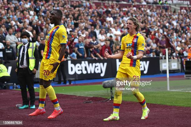 Conor Gallagher of Crystal Palace celebrates after scoring their sides first goal with team mate Christian Benteke during the Premier League match...