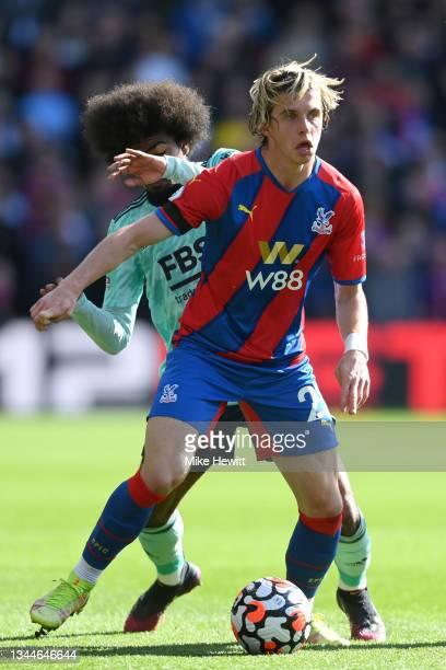 Conor Gallagher of Crystal Palace is challenged by Hamza Choudhury of Leicester City during the Premier League match between Crystal Palace and...