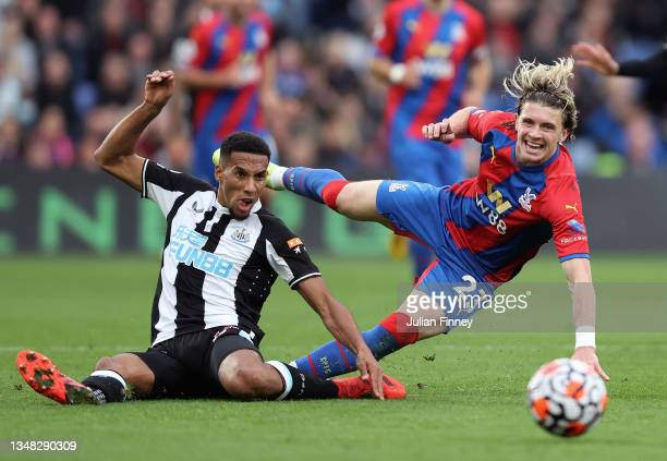 Conor Gallagher of Crystal Palace is challenged by Isaac Hayden of Newcastle United during the Premier League match between Crystal Palace and...