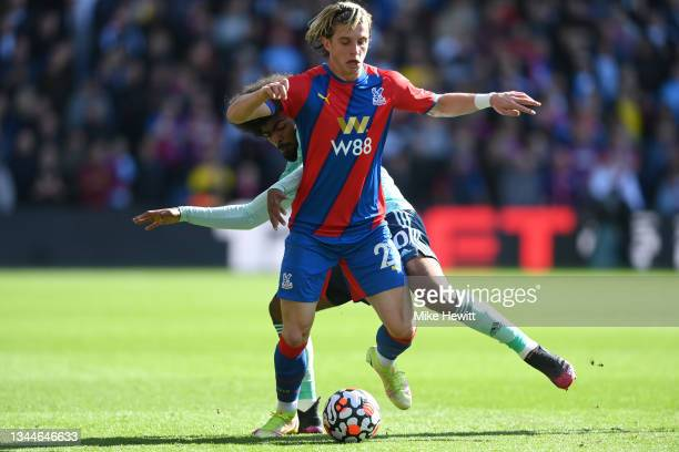 Conor Gallagher of Crystal Palace is tackled by Hamza Choudhury of Leicester City during the Premier League match between Crystal Palace and...