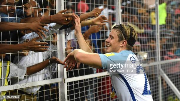 Conor Gallagher of England celebrates with the fans after the FIFA U17 World Cup India 2017 Final match between England and Spain at Vivekananda Yuba...