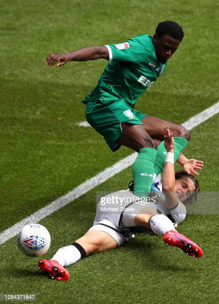 Conor Gallagher of Swansea challenges with Dominic Iorfa of Sheffield Wednesday during the Sky Bet Championship match between Swansea City and...