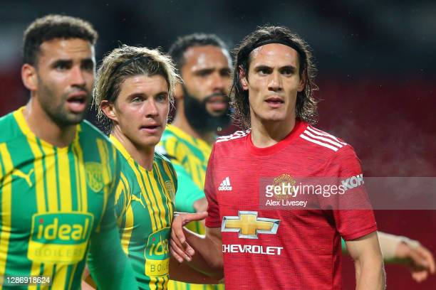 Conor Gallagher of West Bromwich Albion and Edinson Cavani of Manchester United battle for possession as they prepare for a set piece during the...