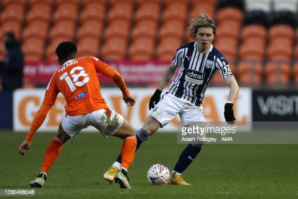 Conor Gallagher of West Bromwich Albion and Grant Ward of Blackpool during the FA Cup Third Round match between Blackpool and West Bromwich Albion on...