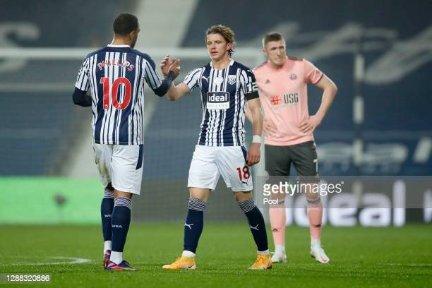 Conor Gallagher of West Bromwich Albion and Matt Phillips of West Bromwich Albion celebrate following their sides victory in the Premier League match...