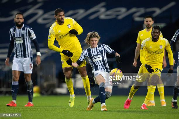 Conor Gallagher of West Bromwich Albion and Ruben Loftus-Cheek and André-Frank Zambo Anguissa of Fulham during the Premier League match between West...