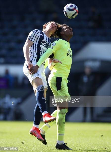 Conor Gallagher of West Bromwich Albion battles for a header with Joe Willock of Newcastle United during the Premier League match between West...