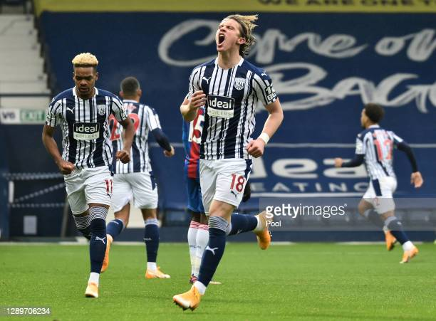 Conor Gallagher of West Bromwich Albion celebrates after scoring their team's first goal as teammate Grady Diangana looks on during the Premier...
