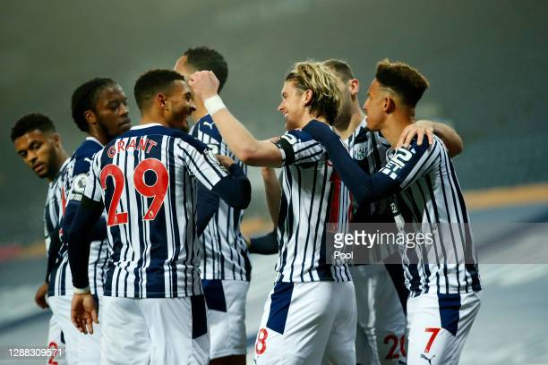 Conor Gallagher of West Bromwich Albion celebrates with teammate Karlan Grant after scoring his team's first goal during the Premier League match...