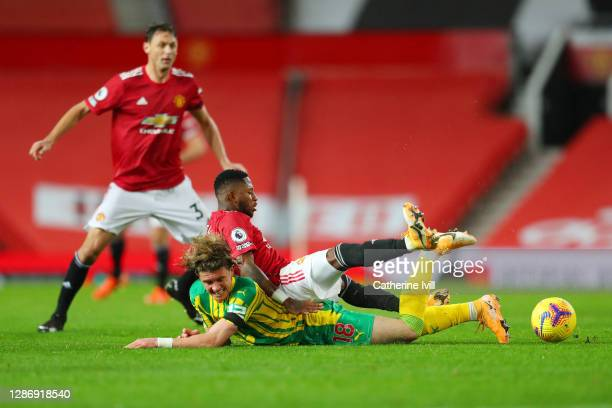 Conor Gallagher of West Bromwich Albion collides with Fred of Manchester United during the Premier League match between Manchester United and West...