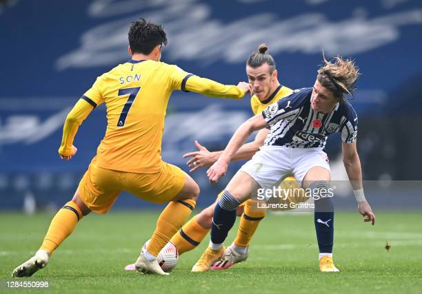 Conor Gallagher of West Bromwich Albion is challenged by Son Heung-Min and Gareth Bale of Tottenham Hotspur during the Premier League match between...
