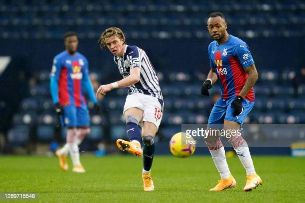 Conor Gallagher of West Bromwich Albion is closed down by Jordan Ayew of Crystal Palace during the Premier League match between West Bromwich Albion...