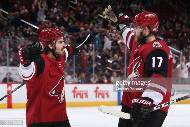 Conor Garland and Alex Galchenyuk of the Arizona Coyotes celebrate after Galchenyuk scored a goal against the San Jose Sharks during the third period...
