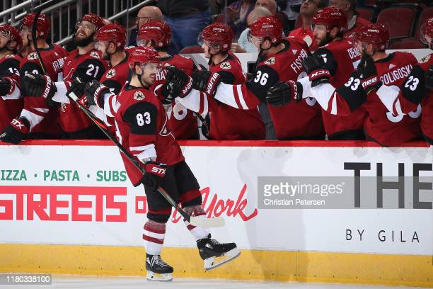 Conor Garland of the Arizona Coyotes celebrates with teammates on the bench after scoring a goal against the Vegas Golden Knights during the second...