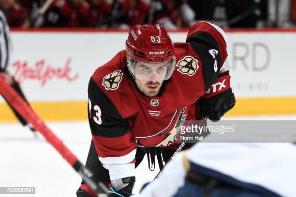 Conor Garland of the Arizona Coyotes gets ready during a face off against the Florida Panthers at Gila River Arena on February 25 2020 in Glendale...
