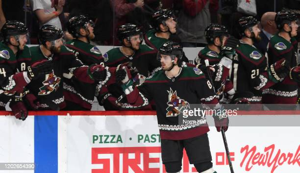 Conor Garland of the Arizona Coyotes is congratulated by teammates after scoring a goal against the Tampa Bay Lightning during the first period of...