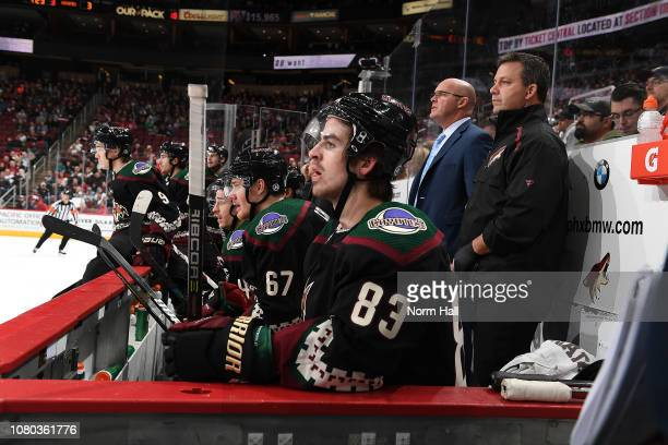 Conor Garland of the Arizona Coyotes looks on from the bench against the San Jose Sharks at Gila River Arena on December 8 2018 in Glendale Arizona...
